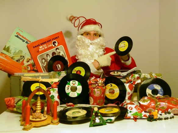 DJ Santa Claus preparing for a funk and soul Christmas Party