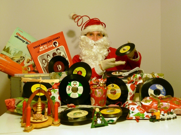 DJ Santa Cluas showing off his beloved Funk and Soul Christmas 45s